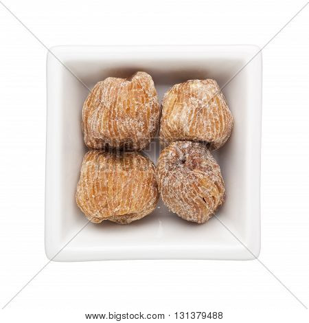 Candied jujubes in a square bowl isolated on white background