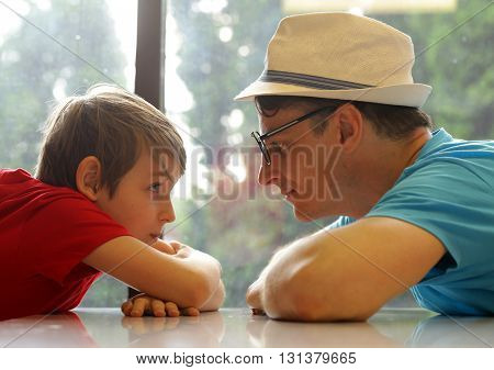 father and son look at each other, family and happiness