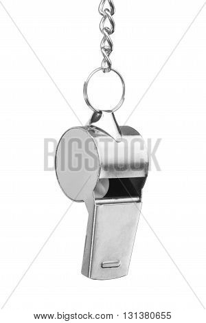 Hanging metal whistle isolated on white background