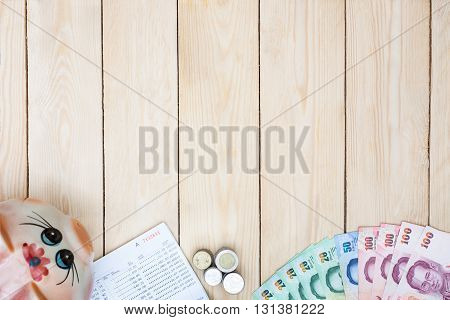 Blank Space With Money And Saving Account Passbook, Book Bank Statement In The Middle Of Office Equi