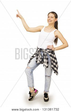 Happy young woman point up or showing some copyspace, isolated on white background