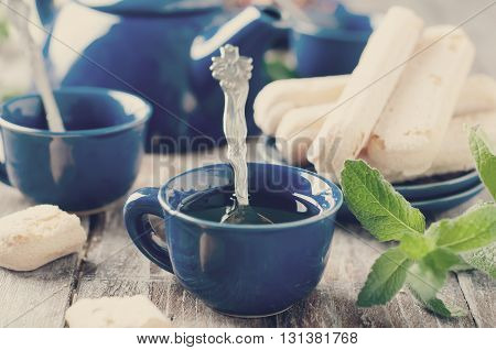 Tea being poured into cup on the backgraund