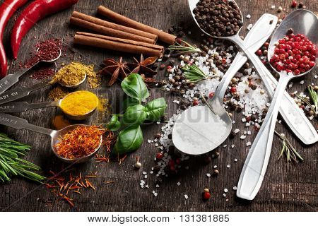 Herbs and spices on wooden table