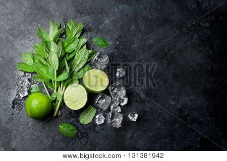 Mint, lime and ice on stone table. Top view with copy space