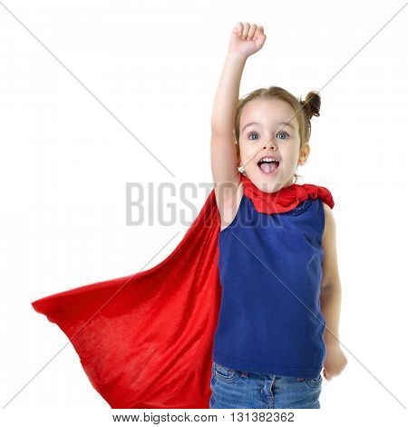 Adorable little girl flying like a superhero in blue t-shirt and red mantle. Super girl. The new generation saves the world. Good triumphs over evil.