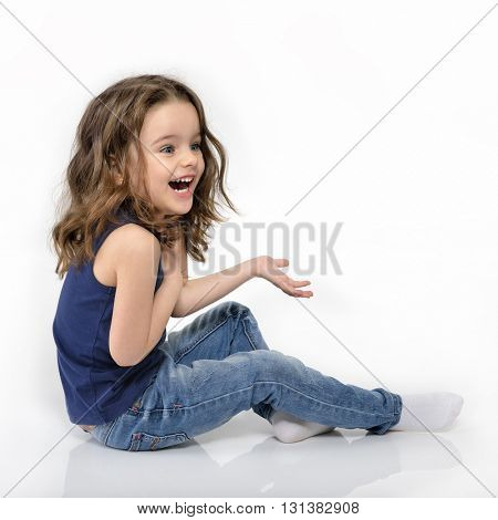 Sweet little happy emotional surprised girl, studio portrait over white background