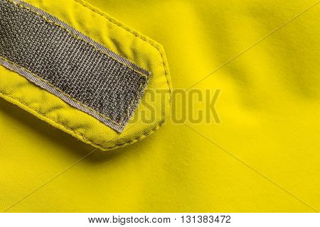Velcro fastener on coat copy space, close up