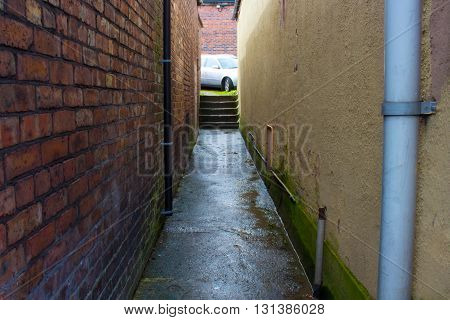 A Dark Wet Alleyway In A Run Down English Town