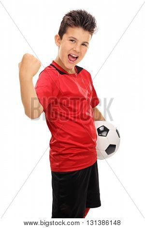Vertical shot of a joyful junior football player with gripped fist isolated on white background