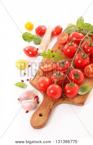 cherry tomato and basil on board