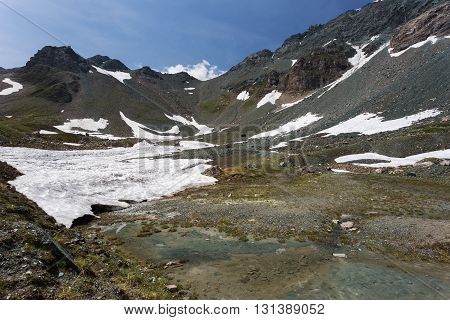 Mountain peaks covered with melting snow. Spring in high mountains