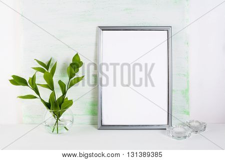 Frame mockup on light green background. Silver frame mockup. Frame mockup. Poster Mockup. Styled mockup. Product mockup. White frame mockup. Empty frame mockup. Design Mockup.