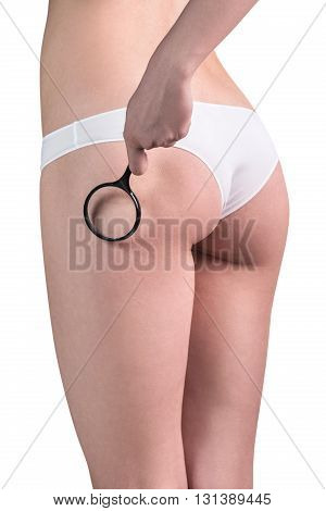 Woman checking cellulite with magnifying glass isolated on background