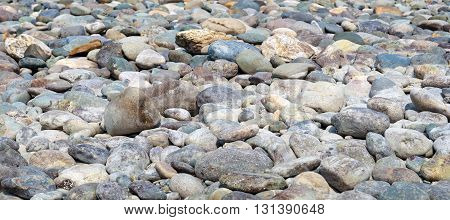 Сoast scene: Natural Polished Pebble or Gravels Background