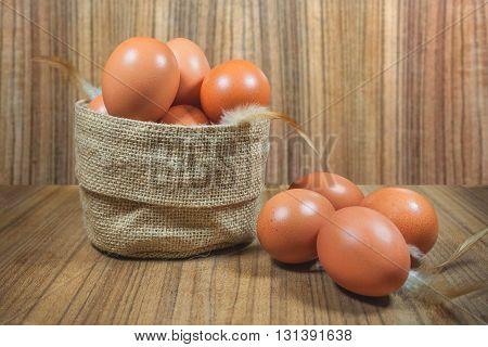 Eggs In Basket On Wood.eggs.egg.brown.rawfood