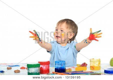 Beautiful child enjoying his game. Shot in a studio.