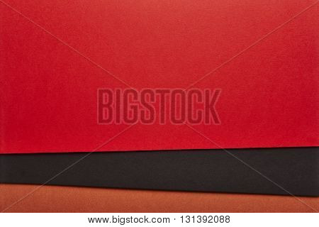 Colored cardboards background in red black brown tone. Copy space. Horizontal