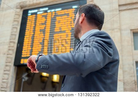 Man checking time in a train station