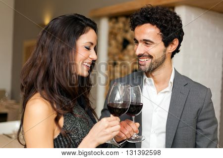 Couple toasting wineglasses in a luxury restaurant