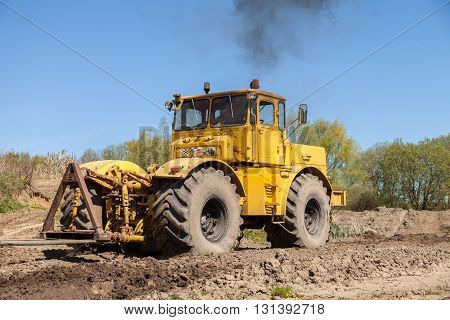 GRIMMEN / GERMANY - MAY 5 2016: Russian Kirowez K 700 tractor on a track in grimmen germany on may 5 2016.