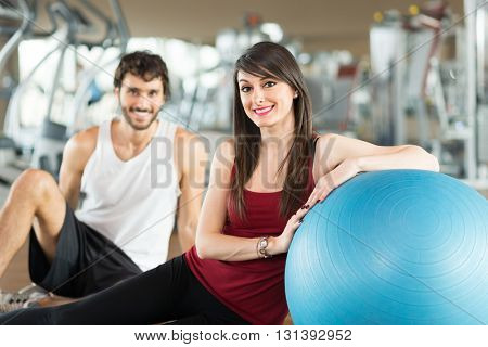 Portrait of a smiling couple in a gym