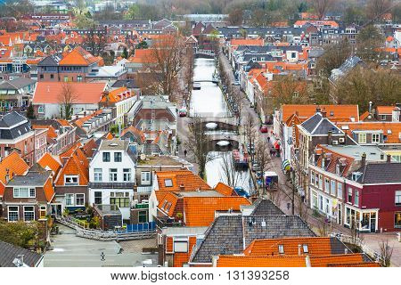 Delft, Netherlands - April 8, 2016: Aerial panoramic downtown street view with canal and houses in Delft, Holland