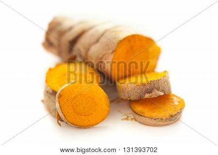 Collection of sliced fresh Organic Long Turmeric or Haldi (Curcuma longa) isolated on white background.