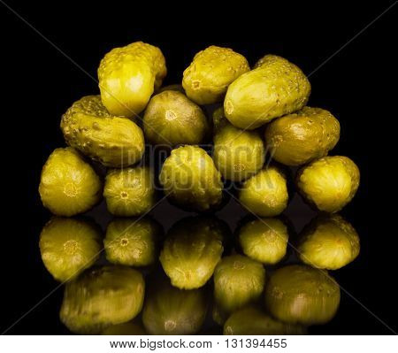 Pickled cucumbers isolated on a black background.