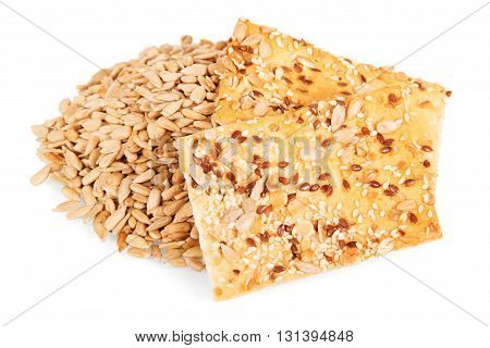 Crunchy biscuits with sunflower seeds, flax and sesame seeds isolated on white background.