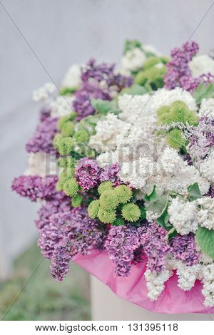 in a vase large bouquet of purple and white lilac