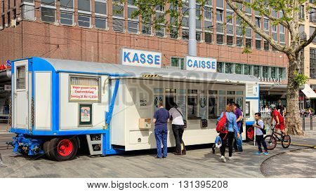 Zurich, Switzerland - 25 May, 2016: people at the trailer serving as the cashier's desk of Circus Knie, temporarily installed on Sechselautenplatz square. Circus Knie is the largest circus in Switzerland, based in Rapperswil, founded in 1803.