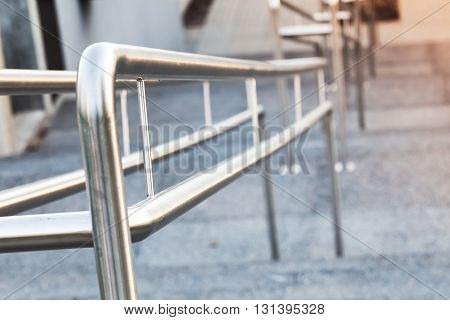 Shining Urban Metal Handrails On A Stairway