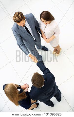 Businessmen shaking hands. Top View