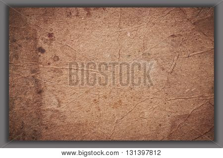 Brown crumpled paper with texture and pattern Brown paper with pattern on gray background Texture of brown paper with pattern for design