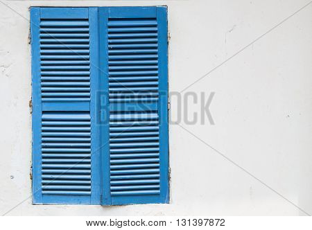 Close up photo of a blue window, left side focus