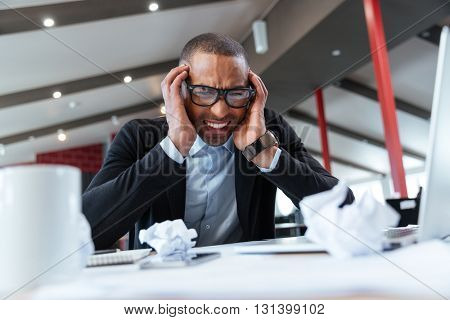Exhausted businessman at work in the office