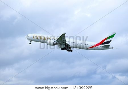 SAINT PETERSBURG RUSSIA - MAY 11 2016. Emirates Airline Boeing 777 aircraft -registration number A6-EBY- is flying in the sky