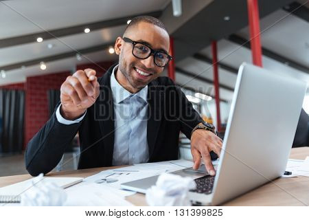 Young handsome businessman pointing at you