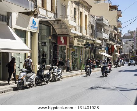 HERAKLION, GREECE - MAY 16: Pedestrians and traffic in a street of Heraklion at May 16, 2016