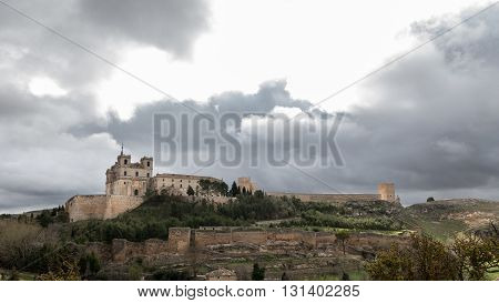 Wide angle view of Monastery at Ucles against cloudy sky, Castilla la Mancha, Spain