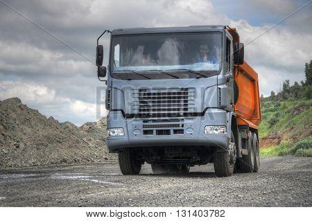 Poltava Region Ukraine - June 26 2010: Dump truck driving along the opencast road
