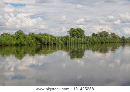 Idyllic scenery of sky reflected in the river.