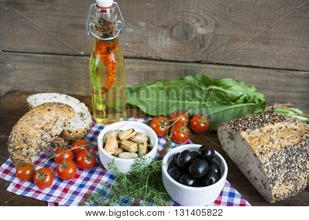 Black Olives And Mussels In Ceramic Bowls, Fresh Tomatoes, Bread And Bottle Of Olive Oil With Spices