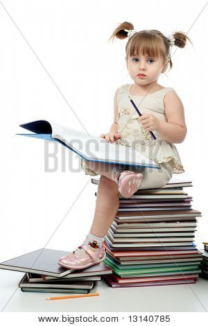 Portrait of a pretty girl with books.