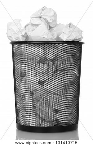 Metal basket with paper waste isolated on white background.