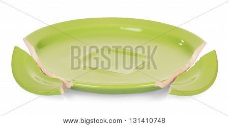 Shards of broken green saucer isolated on white background.