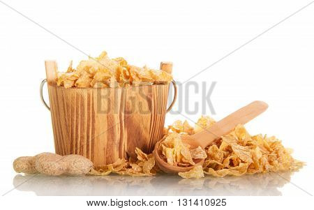 Corn flakes in a wooden bucket and scoop isolated on white background.