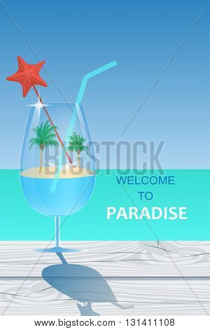 Paradise island with palm trees and hammock is in the cocktail glass standing on the wooden cracked table on the turquoise ocean background