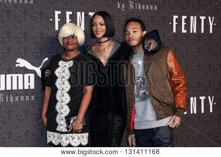 NEW YORK-FEB 12: (L-R) Monica Braithwaite, Rihanna and Rajad Fenty attend the FENTY PUMA by Rihanna AW16 Collection during Fall 2016 New York Fashion Wee on February 12, 2016 in New York City.