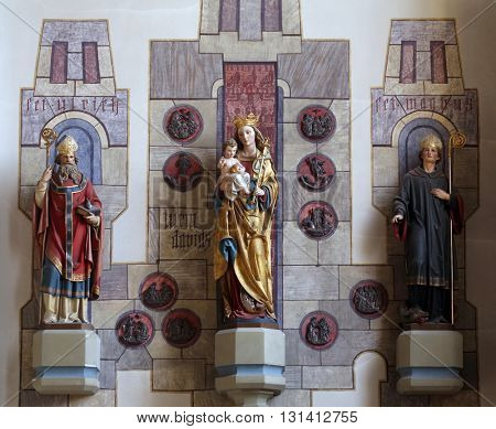 OBERSTAUFEN, GERMANY - OCTOBER 20: Virgin Mary with baby Jesus and Saints Magnus and Ulrich, the parish church of St. Peter and Paul in Oberstaufen, Germany on October 20, 2014.